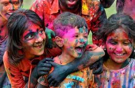 When in India in a suit and tie, watch out for the Holi Festival!